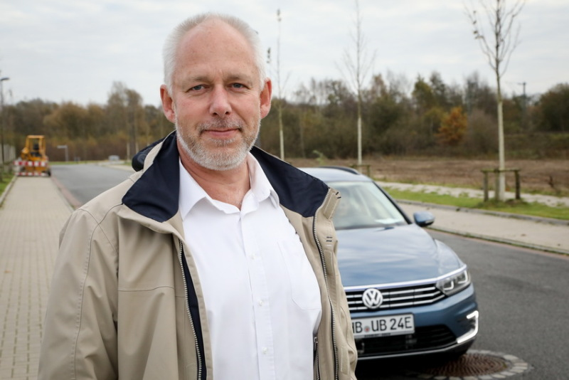 Professor Christof Büskens in front of a car