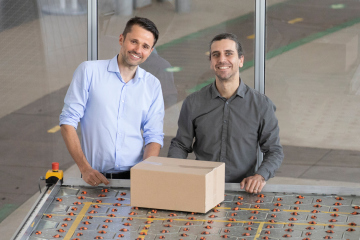 Hendrik Thamer (left) and co-founder Claudio Uriarte (right) with the Celluveyor system, which takes up 95 per cent less space than other conveyor systems.