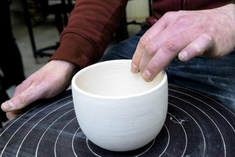 The potter's wheel can be used to fashion beautifully round cups and bowls from a lump of clay.
