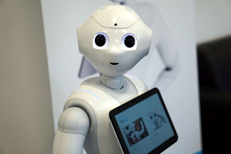 The robot displays information and can be controlled via the large tablet on its chest.